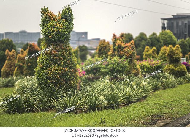 Topiary cats by the roadside in Kuching, Sarawak, Malaysia