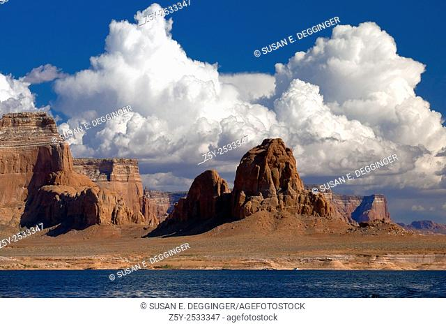 Red rock buttes and clouds on the shores of Lake Powell, Utah