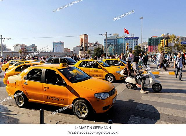 Turkey, Istanbul, Yellow taxis at Taksim Square