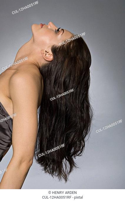 female with hair cascading