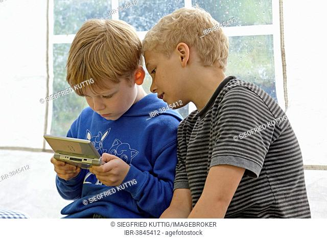 Two boys playing Nintendo
