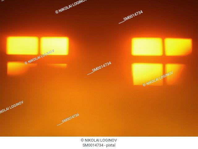 Two orange windows silhouettes bokeh background hd
