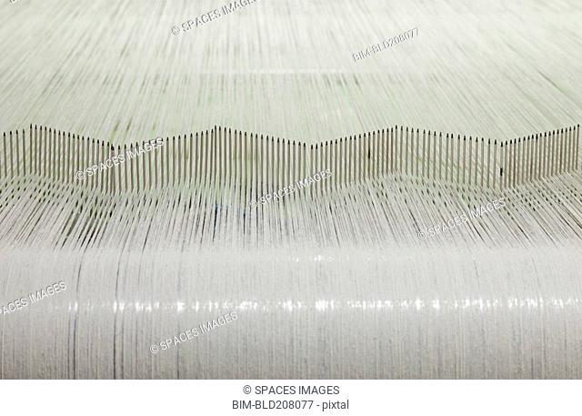 Flax Threads on a Loom