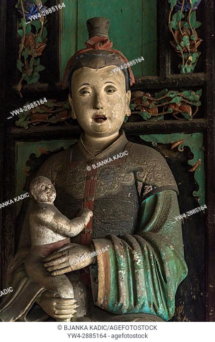 Mother and child sculpture, Hall of the Fertility Goddess, Shuanglin Temple, a large Buddhist temple from the Ming dynasty, Pingyao, Shanxi province, China