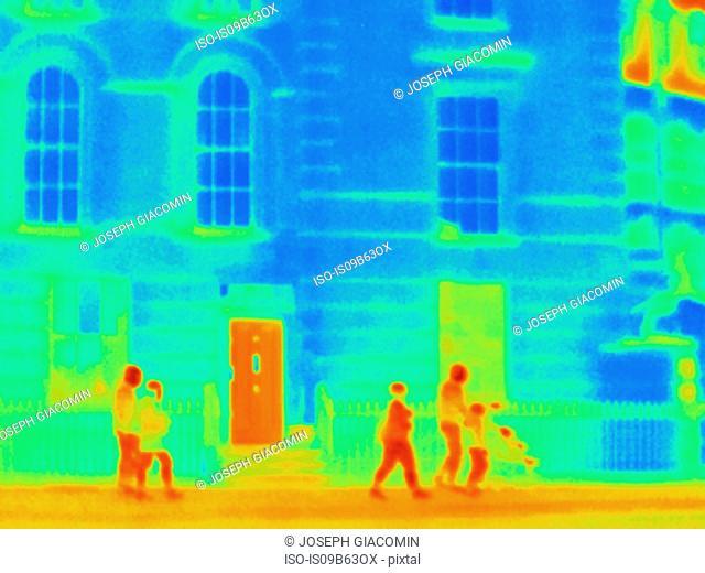 Thermal photograph of tourist group walking along sidewalk, London, UK
