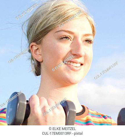 close up woman with dumbbells