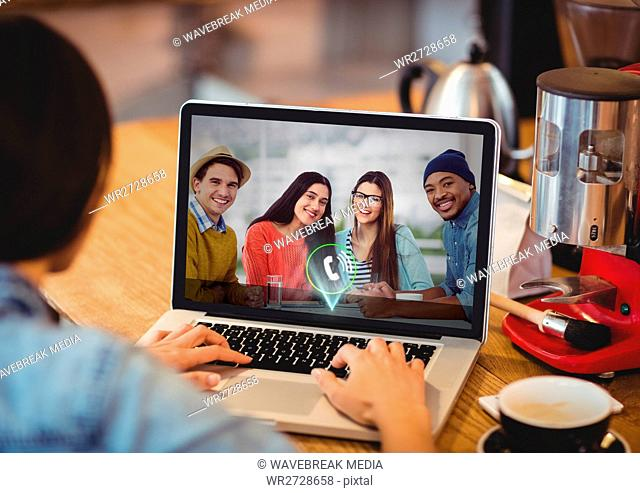 Man having a video call with his friends on laptop