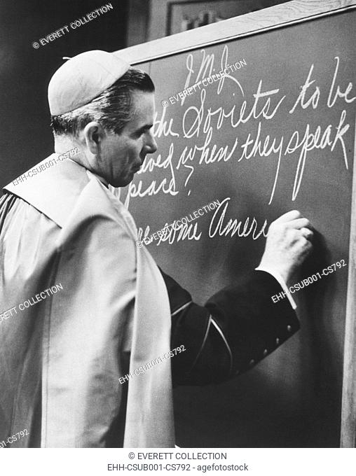 Bishop Fulton Sheen writing on blackboard during the broadcast of his TV show, LIFE IS WORTH LIVING. Nov. 1, 1954. He wrote