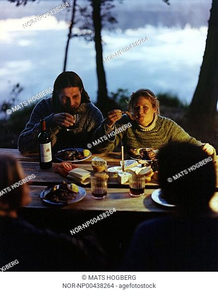 People eating dinner at night