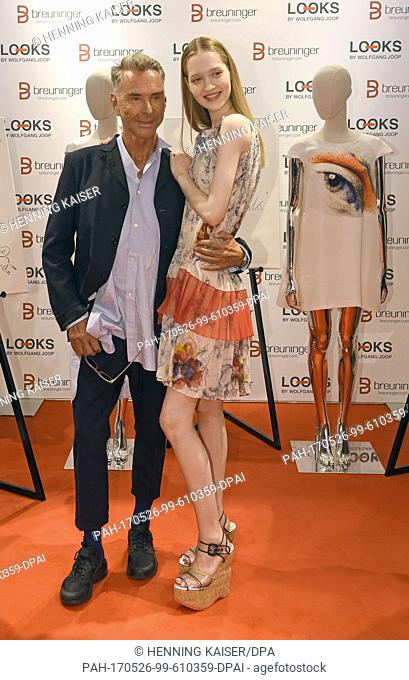 """Fashion designer Wolfgang Joop and model Ivana Teklic present clothes at the presentation of his collection """"""""Looks"""""""" for the textile chain Breuninger in..."""