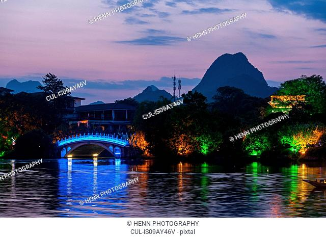 Lit up bridge at Banyan Lake in Guilin, Guangxi, China
