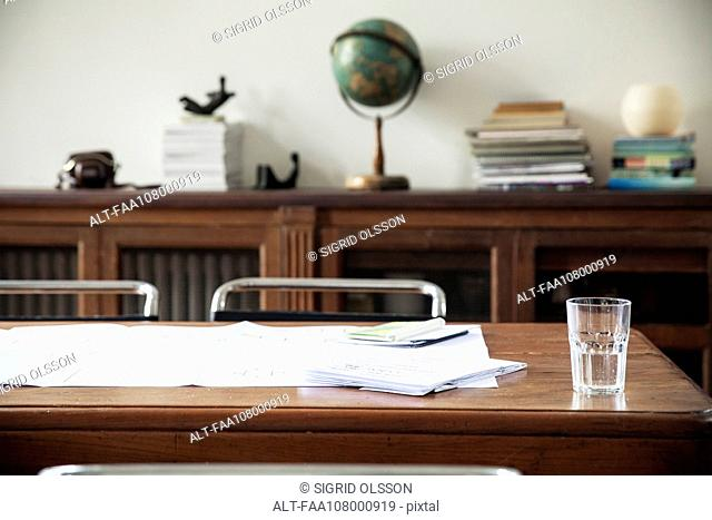 Blueprints on table in office