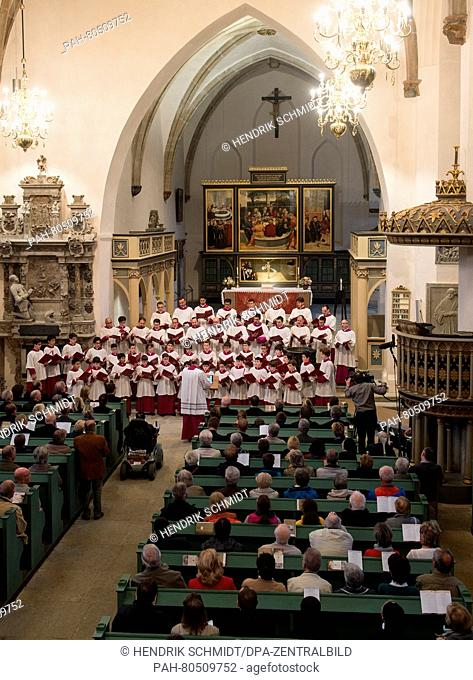 The Vatican-based Sistine Chapel Choir led by its director Massimo Palombella performs during an ecumenical concert held at the St