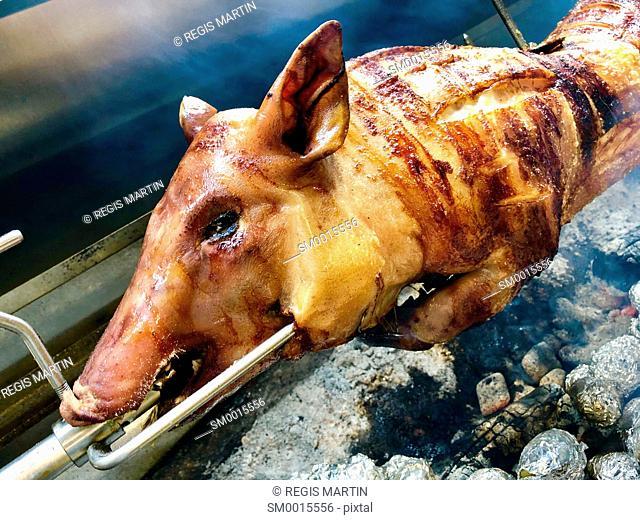 piglet roasting on a spit