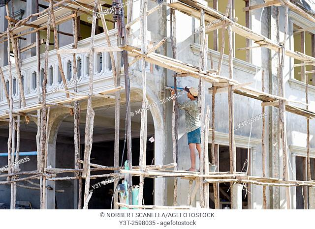 Asia. South-East Asia. Laos. Province of Vang Vieng. Construction of a house with the help of bamboo scaffolding