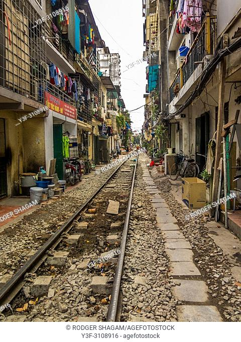 Hanoi Train Street, Vietnam - narrow that residents must ensure their bikes and personal belongings, including roaming children and chickens are all safely...
