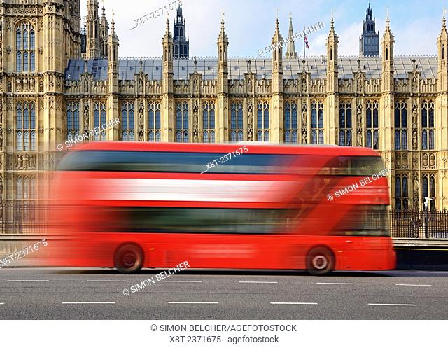 London Bus Going Past the Houses of Parliament, Westminster, London, UK