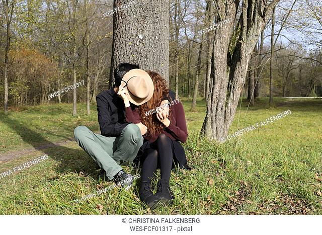 Affectionate couple in the forest in autumn
