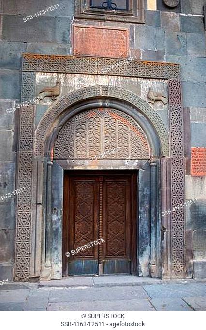 ARMENIA, NEAR YEREVAN, ANCIENT ARMENIAN MONASTERY OF GEGHARD PARTLY CARVED INTO ROCK, DOOR
