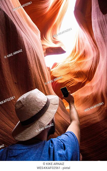 USA, Arizona, Lower Antelope Canyon, tourist photographing
