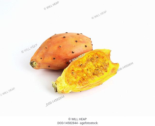Prickly Pear cut into half on white background