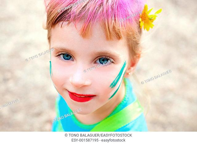 blue eyes children girl painted face makeup in outdoor party