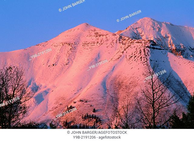 Mears Peak at sunset with fresh autumn snowfall, Uncompahgre National Forest, Colorado, USA