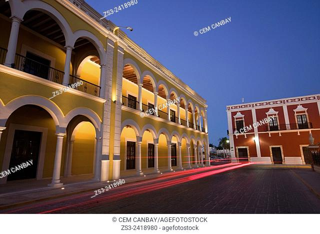 Yellow painted Nacional library building in Zocalo at the historical center listed as World Heritage Site by Unesco at night, Campeche City, Campeche State