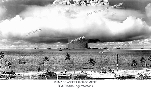 United States detonating an atomic bomb at Bikini Atoll in Micronesia in the first underwater test of the device, 1946
