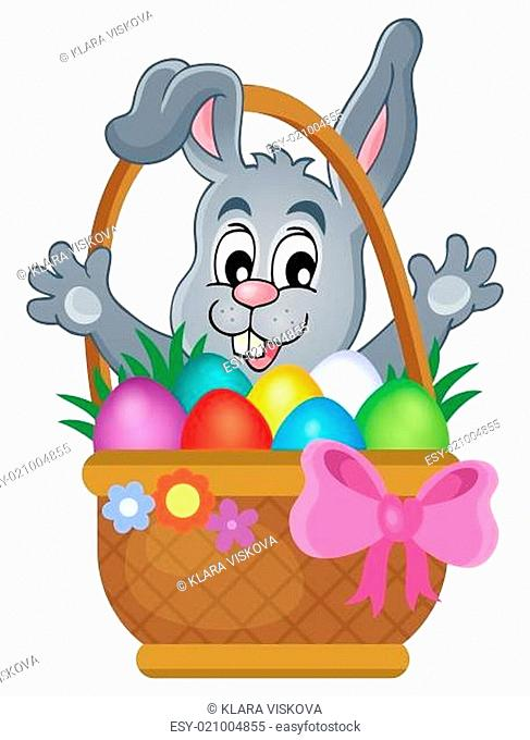 Basket with Easter eggs and happy bunny