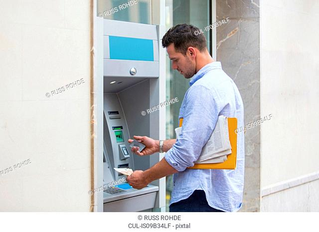 Man withdrawing cash from cash machine