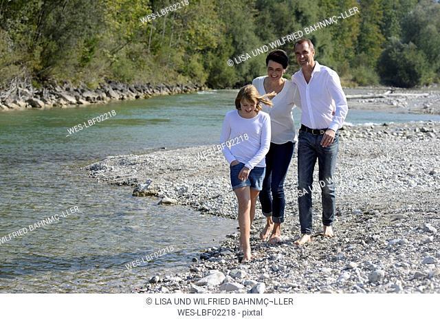 Family walking at the river Isar, Upper Bavaria, Germany