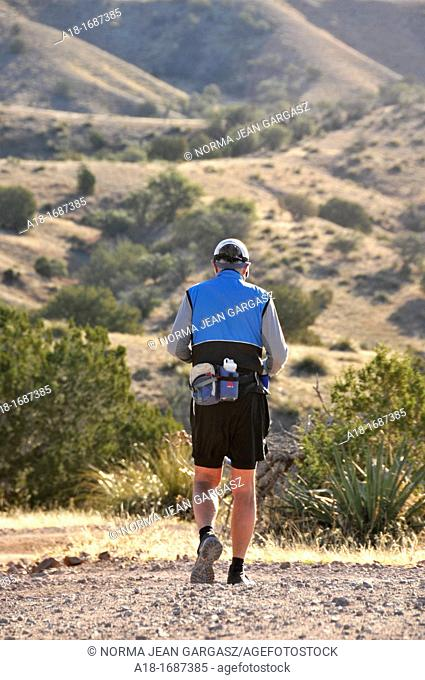 Runners compete in the Old Pueblo 50 Mile Endurance Run on March 3, 2012, in the Santa Rita Mountains in Sonoita, Arizona