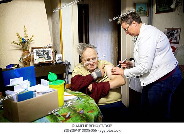 Reportage on a community nurse making home visits in a rural area. She injects a patient with a dose of insulin