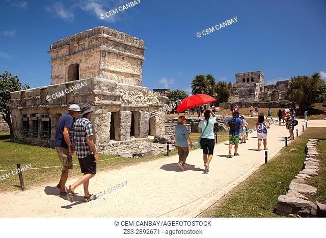 Tourists at the Prehispanic Mayan city of Tulum Archaeological Site, Tulum, Riviera Maya, Quintana Roo, Mexico, Central America