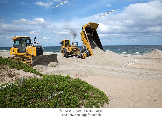 Fort Lauderdale, Florida - Sand is added to the Atlantic Ocean seashore as part of a beach restoration project. The project aims to widen eroded beaches by...