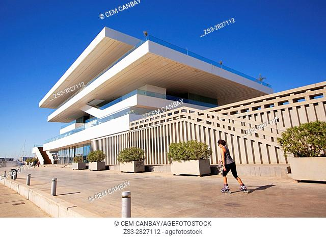 Woman on skateboard in front of the Veles e Vents, building by David Chipperfield, Port Americas Cup, Valencia, Spain, Europe
