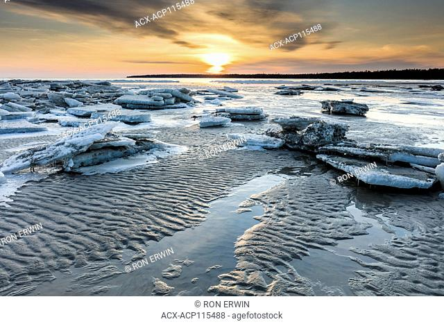 Melting ice on Singing Sands Beach at Dorcas Bay in Bruce Peninsula National Park, Ontario, Canada