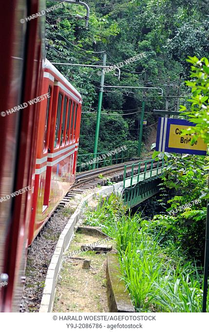 """Rio de Janeiro, Brazil: Famous train """"""""Trem do Corcovado"""""""" travelling up to the mountain top of Corcovado with it's christ statue Cristo Redentor"