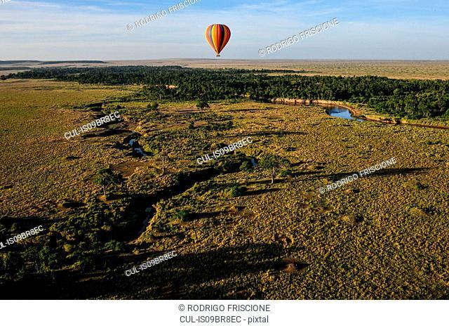 Air balloon floating over Mara River, Kenya