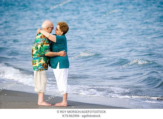 Senior couple hugging at the beach