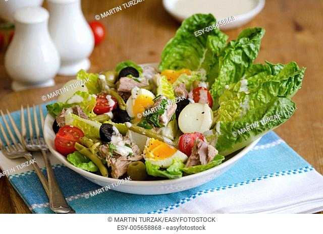 Freshly made salad Nicoise in a bowl