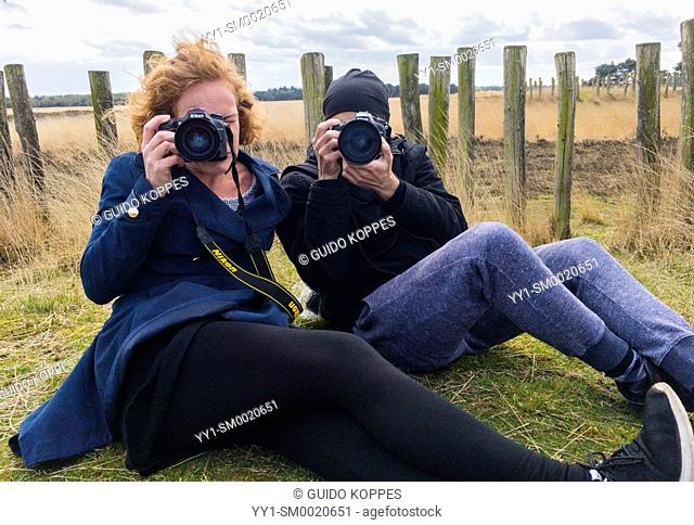 Regte Heide, Riel, Netherlands. Two photographers targeting the same subject: another photographer