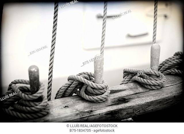 Closeup of old sailboat deck with ropes tied