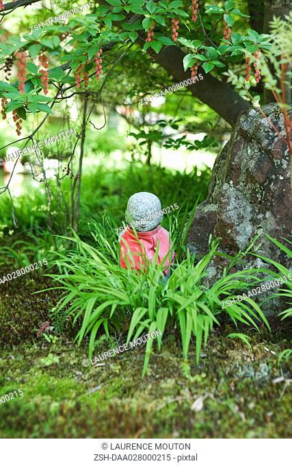 Statuette in ornamental garden