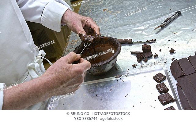 organic craftsman chocolate frigoulette, final phase for this preparation. Beaufort on Gervanne. the drome, france