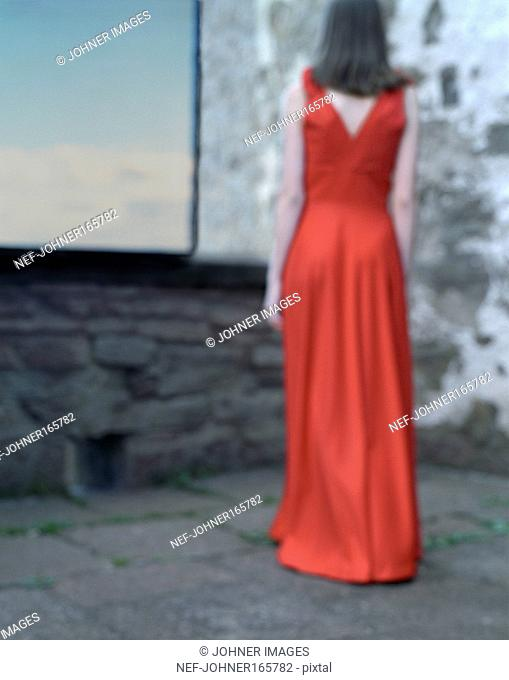 A Woman in a Red Evening Dress