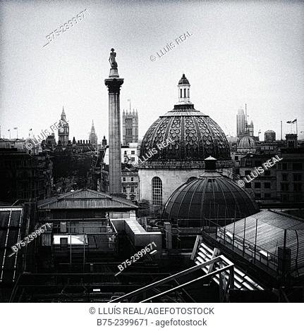 Dome of the National Gallery and Nelson column in Trafalgar Square, Big Ben and Houses of Parliament, view from a window of Portrait Gallery in the center of...