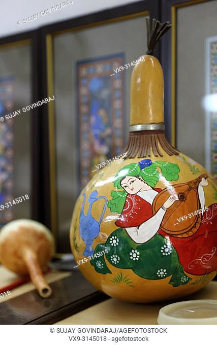 Tashkent, Uzbekistan - May 02, 2017: Close-up of a finished painted dry pumpkin in Uzbek traditional style at Madrasa
