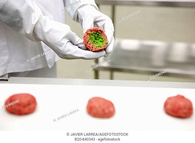 Researcher preparing vegetable-filled meatballs using food co-extrusion technology, pilot plant, AZTI-Tecnalia, Technology Centre for Marine and Food Research